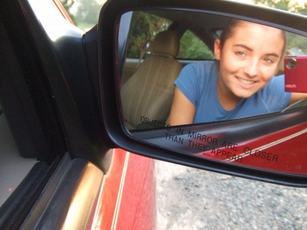 girl car sideview mirror camera