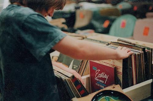 kid looking at records
